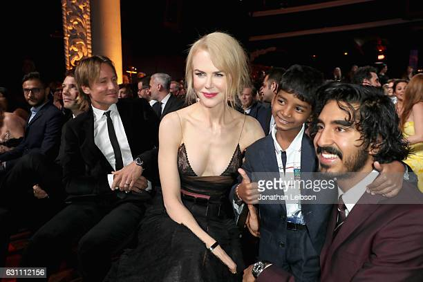Singer Keith Urban actors Nicole Kidman Sunny Pawar and Dev Patel attend The 6th AACTA International Awards on January 6 2017 in Los Angeles...