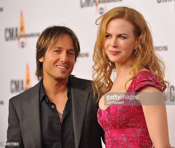 Singer Keith Urban and wife actress Nicole Kidman arrive at the 43rd Annual CMA Awards at the Sommet Center on November 11 2009 in Nashville Tennessee