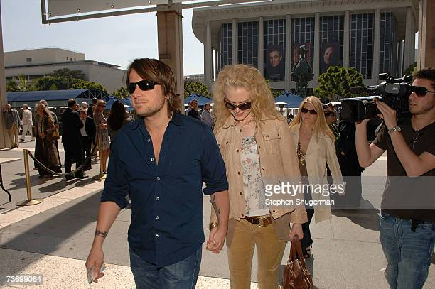 Singer Keith Urban and wife actress Nicole Kidman attend the World Premiere of 'Distracted' starring Rita Wilson at the Mark Taper Forum on March 25...
