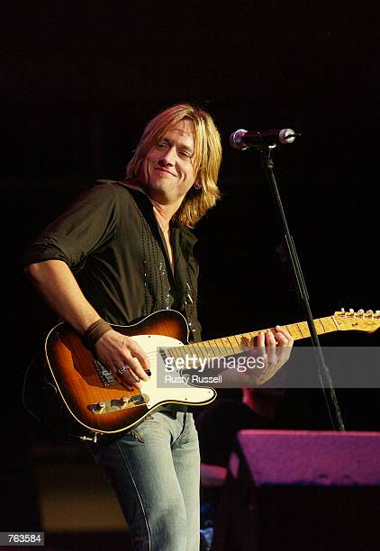 Singer Keith Urban performs at FanFair the world's largest country music festival June 15 2002 in Nashville Tennessee