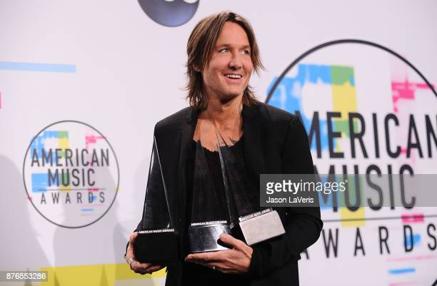 Singer Keith Urban poses in the press room at the 2017 American Music Awards at Microsoft Theater on November 19 2017 in Los Angeles California