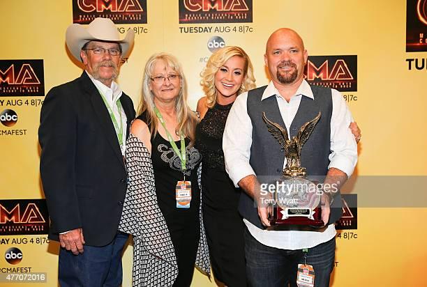 Singer Kellie Pickler is presented the Chris Kyle Operation Troop Aid American Patriot Award by Chris Kyle's parents Wayne and Debbie Kyle at the...