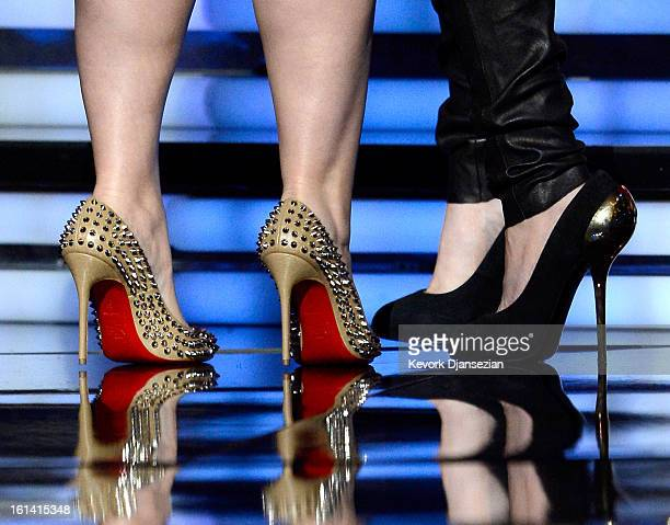 Singer Kelly Clarkson and actress Kaley Cuoco onstage at the 55th Annual GRAMMY Awards at Staples Center on February 10 2013 in Los Angeles California