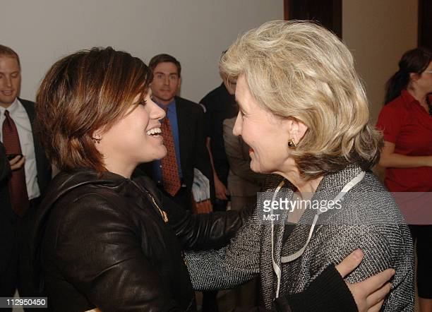 Singer Kelly Clarkson left meets with US Sen Kay Bailey Hutchison on Capitol Hill in Washington DC on September 6 2006