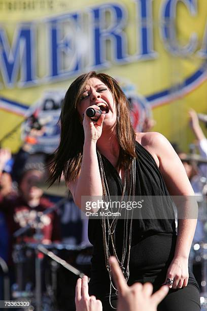 Singer Kelly Clarkson performs during the Nextel Tribute to America, prior to the NASCAR Nextel Cup Series Daytona 500 at Daytona International...