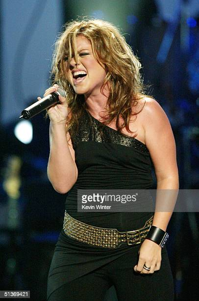Singer Kelly Clarkson performs on stage at the 5th Annual 'Women Rock' Lifetime Television's fifth annual signature concert for the fight against...