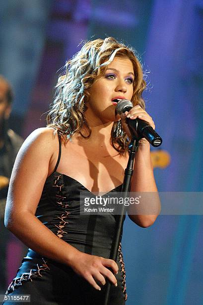 Singer Kelly Clarkson performs on The Tonight Show with Jay Leno at the NBC Studios on August 9 2004 in Burbank California
