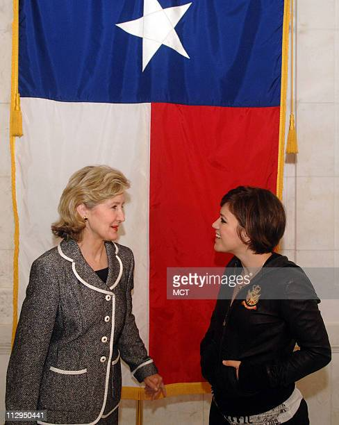 Singer Kelly Clarkson right meets with US Sen Kay Bailey Hutchison on Capitol Hill in Washington DC on September 6 2006