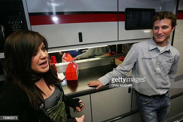 Singer Kelly Clarkson speaks with NASCAR driver Kasey Khane prior to the NASCAR Nextel Cup Series Daytona 500 at Daytona International Speedway on...