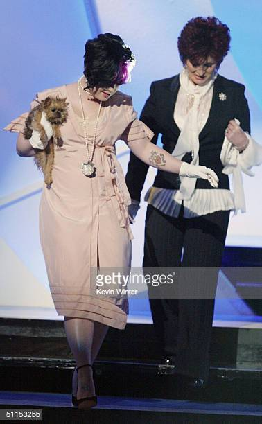 Singer Kelly Osbourne and her mother talk show host Sharon walk on stage at The 2004 Teen Choice Awards held on August 8 2004 at Universal...