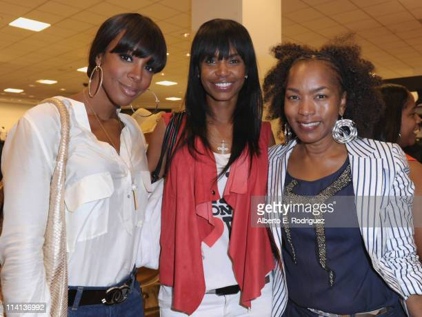 Singer Kelly Rowland actress Kim Porter and actress Angela Bassett attend a personal appearance by Simone I Smith at Bloomingdale's on May 12 2011 in...