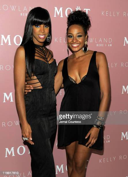 Singer Kelly Rowland and media personality Janell Snowden pose for a photo at the Moet Rose Lounge during the launch celebration for Kelly Rowland's...