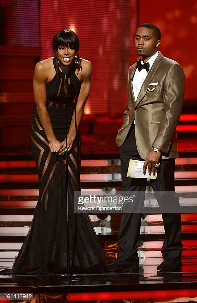 Singer Kelly Rowland and rapper Nas speak onstage at the 55th Annual GRAMMY Awards at Staples Center on February 10 2013 in Los Angeles California