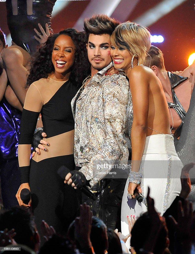 Singer Kelly Rowland, host Adam Lambert and singer Keri Hilson onstage at 'VH1 Divas' 2012 held at The Shrine Auditorium on December 16, 2012 in Los Angeles, California.