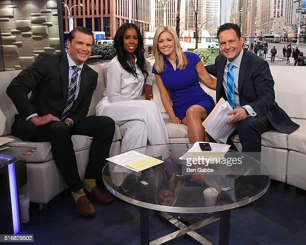 Singer Kelly Rowland is interviewed by cohosts Pete Hegseth Ainsley Earhardt and Brian Kilmeade during Fox And Friends at FOX Studios on March 21...