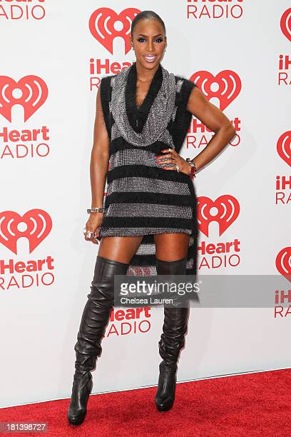 Singer Kelly Rowland poses in the iHeartRadio music festival photo room on September 20 2013 in Las Vegas Nevada