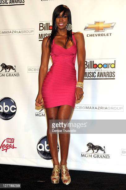 Singer Kelly Rowland poses in the press room during the 2011 Billboard Music Awards at the MGM Grand Garden Arena May 22 2011 in Las Vegas Nevada
