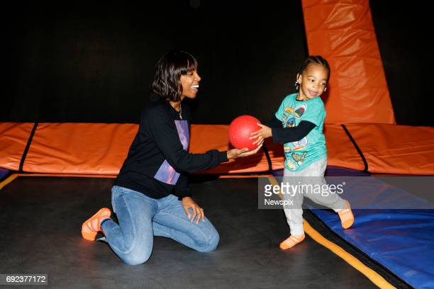 SYDNEY NSW Singer Kelly Rowland with her son Titan Jewell Witherspoon enjoys the trampolines at Skyzone in Aleaxandria Sydney New South Wales