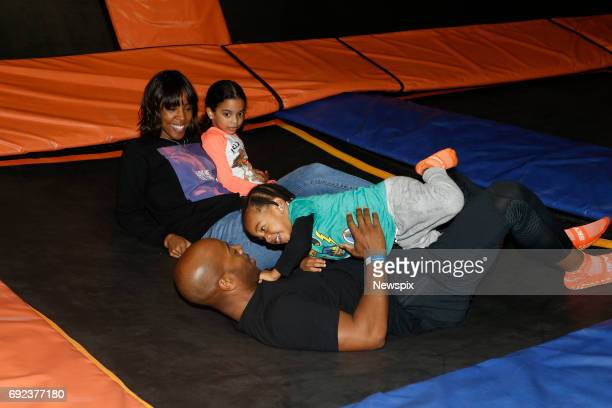 SYDNEY NSW Singer Kelly Rowland with her son Titan Jewell Witherspoon Tim Witherspoon and god daughter Lola enjoy the trampolines at Skyzone in...
