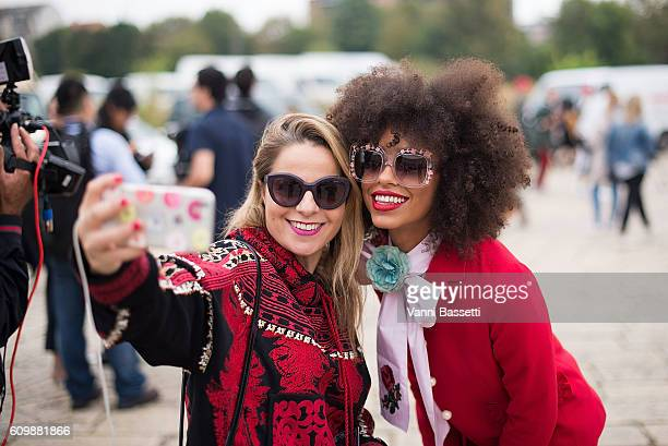 Singer Kelsey Lu poses for a selfie with a fan before the Gucci show during Milan Fashion Week Spring/Summer 2017 on September 21 2016 in Milan Italy