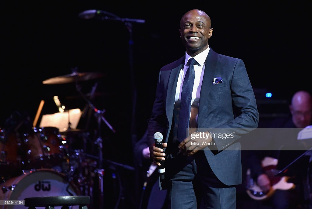 Singer Kem performs onstage at the 12th Annual MusiCares MAP Fund Benefit Concert Honoring Smokey Robinson at The Novo by Microsoft on May 19, 2016 in Los Angeles, California.