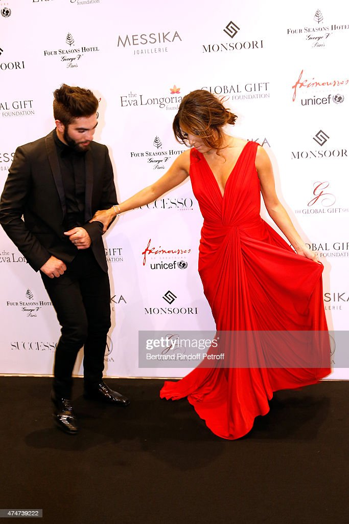 Singer Kendji Girac and Eva Longoria attend the Global Gift Gala : Photocall. Held at Four Seasons Hotel George V on May 25, 2015 in Paris, France.