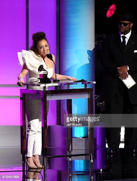 Singer Kendra Foster of The Vanguard accepts the award for Best RB Song for 'Really Love' alongside record producer Jimmy Jam onstage during The 58th...