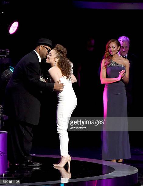 Singer Kendra Foster of The Vanguard accepts the award for Best RB Song for 'Really Love' from record producer Jimmy Jam onstage during The 58th...