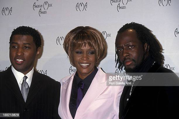Singer Kenneth Babyface Edmonds singer Whitney Houston and musician Wylcef Jean attend the 26th Annual American Music Awards on January 11 1999 at...