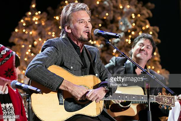 Singer Kenny Loggins performs at The Hollywood Christmas Parade benefitting Toys For Tots Foundation Show on December 1, 2013 in Hollywood,...