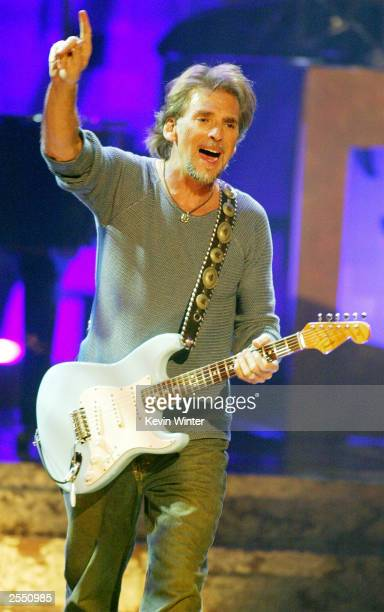 Singer Kenny Loggins performs on stage during the WOMEN ROCK Songs from the Movies the fourth annual concert for the fight against breast cancer at...