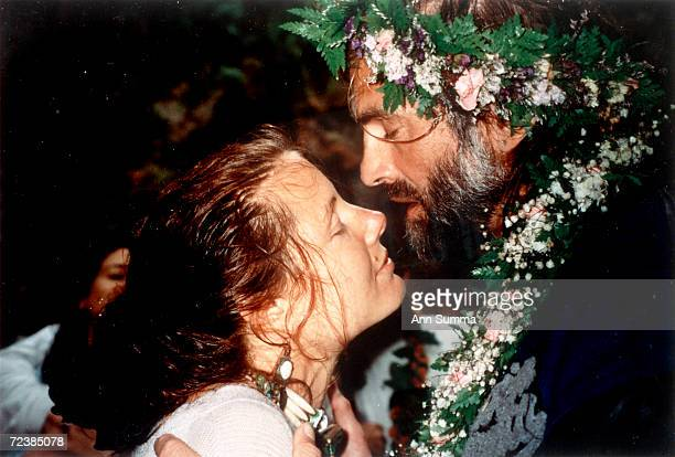 Singer Kenny Loggins with his 2nd wife, therapist Julia Cooper, at their rain-soaked 1992 nuptials.
