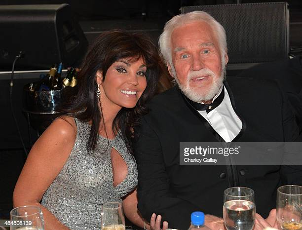 Singer Kenny Rogers and Wanda Miller attend Muhammad Ali's Celebrity Fight Night XX held at the JW Marriott Desert Ridge Resort Spa on April 12 2014...