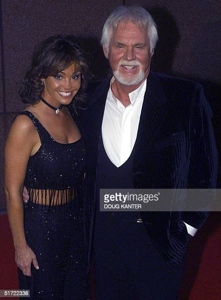 Singer Kenny Rogers and wife Wanda arrive for the Michael Jackson concert at Madison Square Garden in New York 07 Septmeber 2001 AFP PHOTO/Doug KANTER