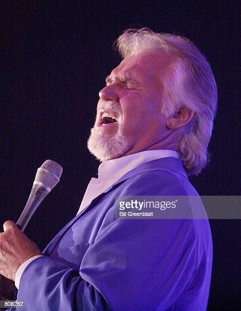 Singer Kenny Rogers performs at the St Louis Variety Club's Telethon dinner April 21 2001 at the Adams Mark Hotel in St Louis Missouri