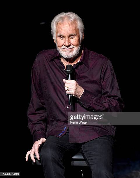 """Singer Kenny Rogers performs onstage during his final world tour """"The Gambler's Last Deal"""" at the Civic Arts Plaza on June 30, 2016 in Thousand Oaks,..."""