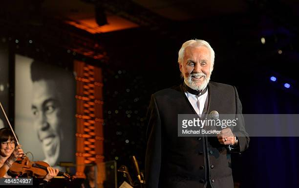 Singer Kenny Rogers performs onstage during Muhammad Ali's Celebrity Fight Night XX held at the JW Marriott Desert Ridge Resort Spa on April 12 2014...