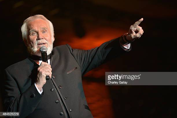 Singer Kenny Rogers performs onstage during Muhammad Ali's Celebrity Fight Night XX held at the JW Marriott Desert Ridge Resort & Spa on April 12,...