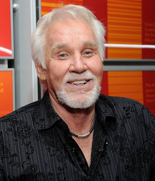 Singer Kenny Rogers poses after An Evening With Kenny Rogers at The GRAMMY Museum on March 28 2011 in Los Angeles California