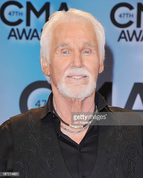 Singer Kenny Rogers poses in the press room at the 47th annual CMA Awards at the Bridgestone Arena on November 6 2013 in Nashville Tennessee