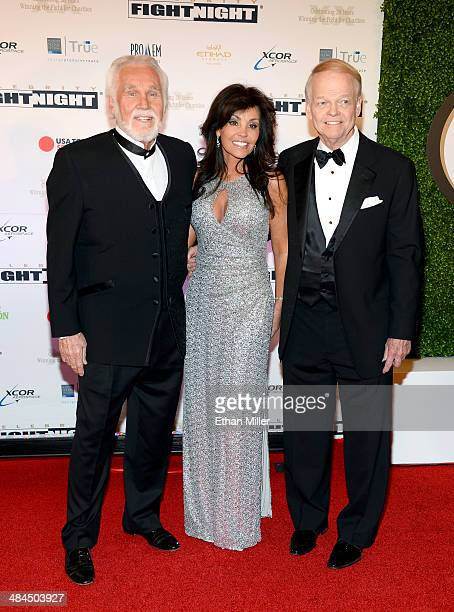 Singer Kenny Rogers Wanda Miller and Chairman and Founder of Celebrity Fight Night Jimmy Walker attend Muhammad Ali's Celebrity Fight Night XX held...