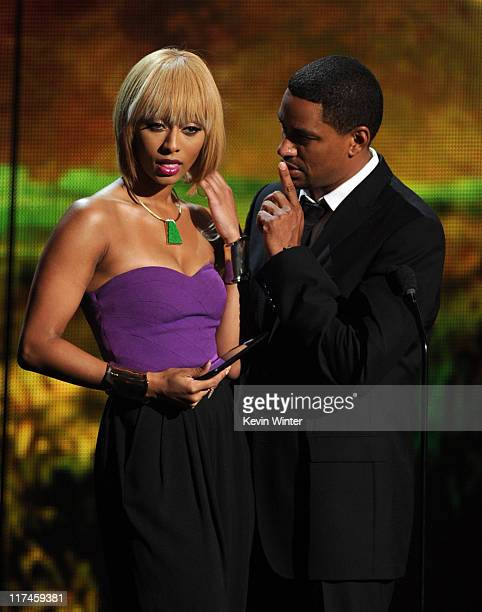 Singer Keri Hilson and actor Laz Alosno speak onstage during the BET Awards '11 held at the Shrine Auditorium on June 26, 2011 in Los Angeles,...