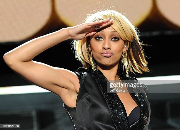 Singer Keri Hilson performs onstage during VH1 Divas Salute the Troops presented by the USO at the MCAS Miramar on December 3 2010 in Miramar...