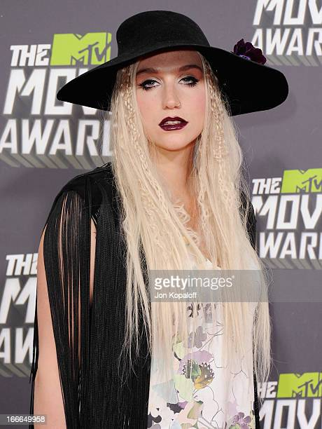 Singer Kesha arrives at the 2013 MTV Movie Awards at Sony Pictures Studios on April 14 2013 in Culver City California