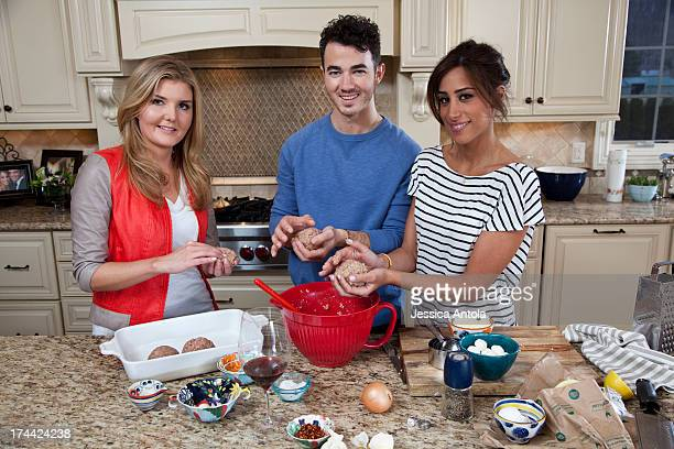 Singer Kevin Jonas and his wife Danielle Jonas are photographed in their home for Cosmopolitan Magazine on March 26 2013 in Denville New Jersey The...