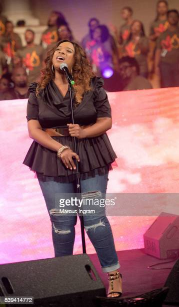 Singer Kierra Sheard performs on stage during Tasha Cobbs Leonard Heart Passion Pursuit album release concert at The dReam Center Church of Atlanta...