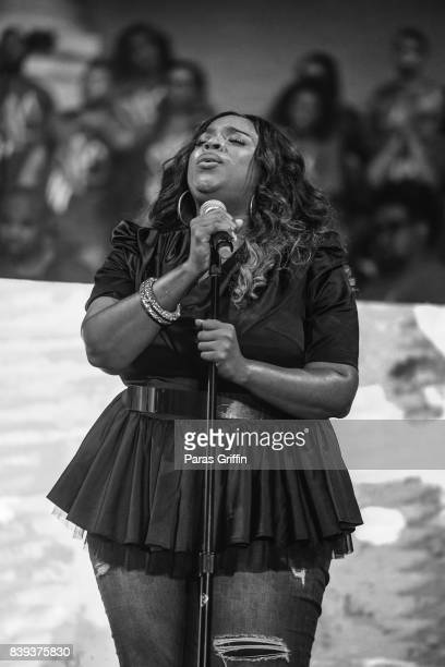 Singer Kierra Sheard performs onstage at Tasha Cobbs Leonard Heart Passion Pursuit Album Release Concert at The dReam Center Church of Atlanta on...