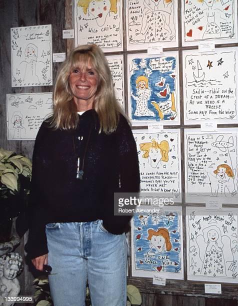 Singer Kim Carnes stands in front of a display of her artworks in 2001 She was among several music industry celebrities who performed or exhibited...