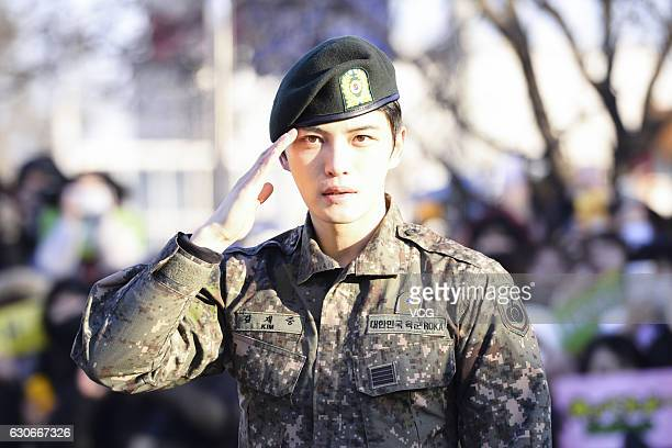 Singer Kim JaeJoong of South Korean boy band JYJ poses for fans after he was discharged from military service on December 30 2016 in Yongin South...