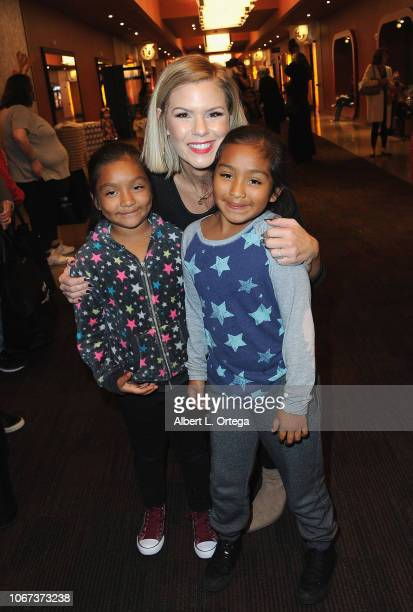 Singer Kimberly CaldwellHarvey of 'American Idol' passes out toys to children at the 2018 Venice Family Clinic's 31st annual Children's Holiday Movie...